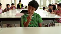 作品画像:スプーン曲げを教える(レッスン5、高松国分寺ホール、2013)