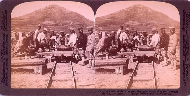 Carrying loaded shells to great siege guns bombarding the TownAnd Harbor, PortArthur.