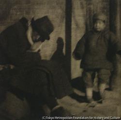 作品画像:帽子をかぶった男と子供