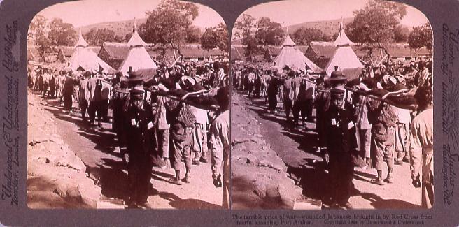 作品画像:The terrible price of war―wounded Japanese brought in by Red Cross from fearfulAssaults PortArthur.