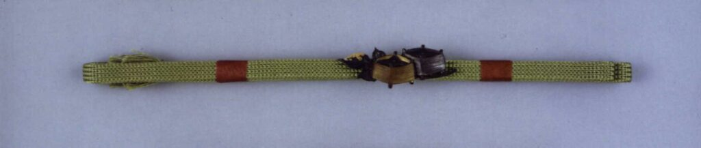 作品画像:糸巻彫帯留付帯締